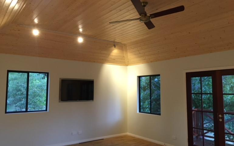 Coved timber T&G ceiling adds warmth